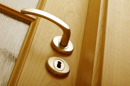 view of a wooden doorway: Lock and door handle  Stock Photo