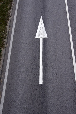 White arrow on Surface traffic Stock Photo - 12251027