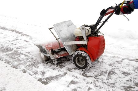 Man working with a snow blowing machine  photo