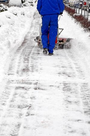 Man working with a snow blowing machine  Stock Photo - 12251030