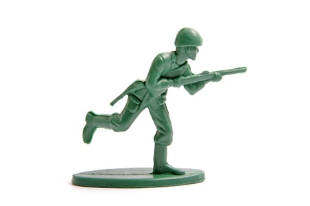 plastic soldier: green toy soldiers on white background