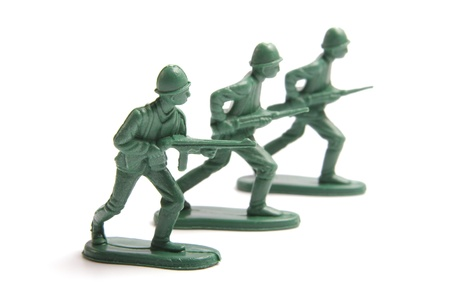 Three toy soldiers on a white background  Stock Photo