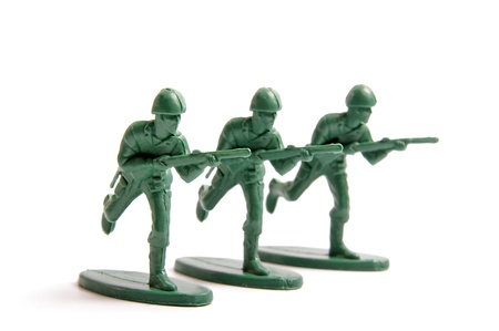 green plastic soldiers: Three toy soldiers on a white background  Stock Photo
