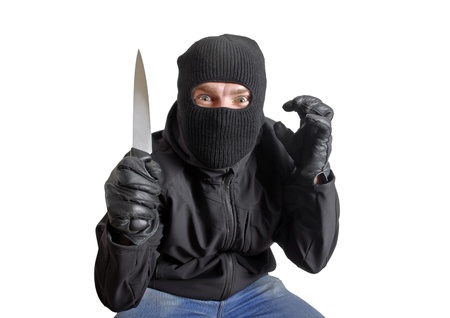 Masked criminal holding a knife, isolated on white