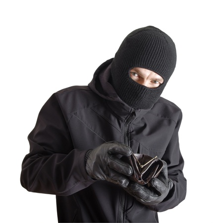 Masked criminal holding a stolen leather purse, isolated on white Stock Photo - 12935390