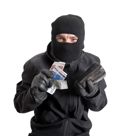 Masked criminal holding a stolen leather purse, isolated on white   photo