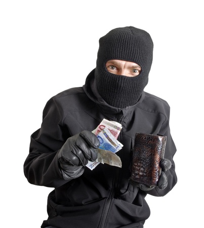 Masked criminal holding a stolen leather purse, isolated on white Stock Photo - 12935400
