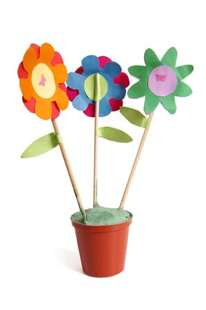 Three colorful paper flowers made by child photo