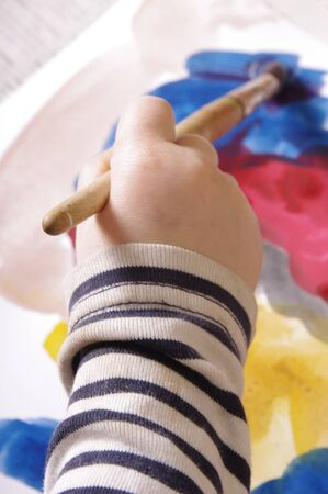 childs hand painting onthe papper photo