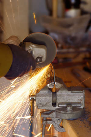 forger: The smith are cutting steel with electric saw