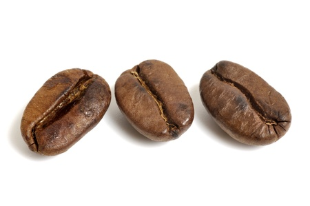 caf: Three coffee beans on white background