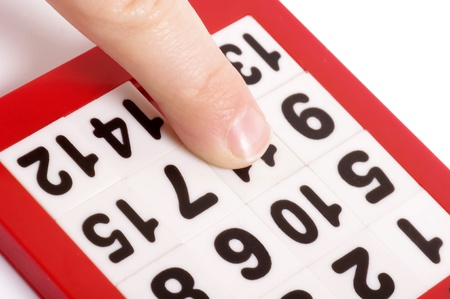 Numbers puzzle and finger Stock Photo - 17562229