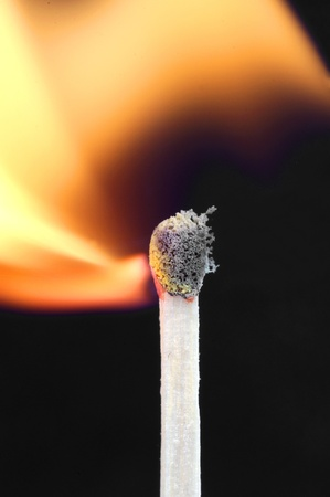Burning match on a black background Stock Photo - 17562234