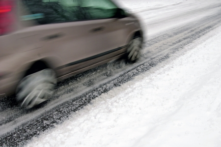 traction: Snowy road surface from the back of car  Stock Photo
