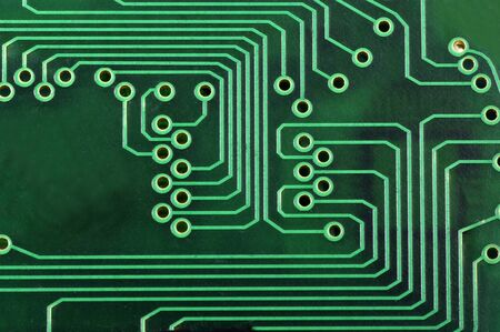macro of a green circuit board  photo