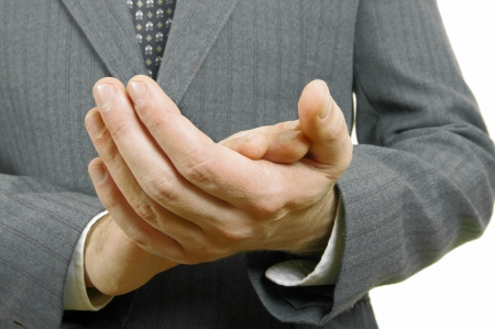 Close up businessman clapping his hands in the office photo