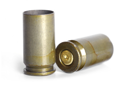 spent: Empty 9mm bullet casings over white background Stock Photo