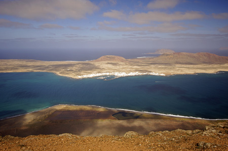 mirador: The Island of La Graciosa and the port of Caleta del Sebo taken from the Mirador del Rio, a famous viewpoint on Lanzarote, in the Spanish Canary Islands.