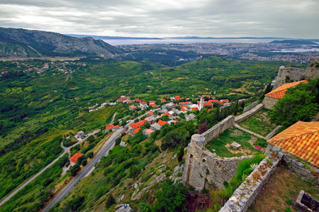 Klis - Medieval fortress in Croatia near Split in Dalmatia.Before storm. photo