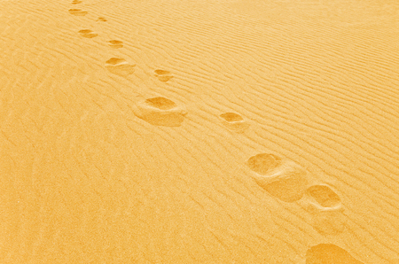 foot step: Foot step on the sand Stock Photo