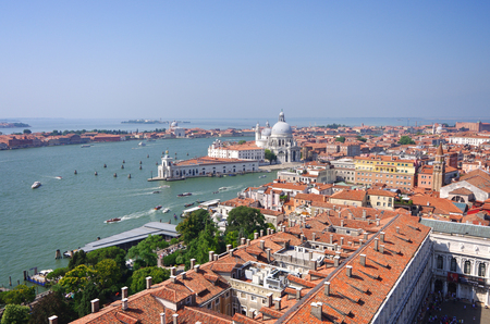 bird       s house: Panorama of Venice view from St. Marks Campanile on famous Basilica Santa Maria della Saluteand Grand Canal, colored photo.