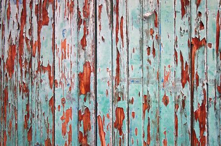 exfoliate: Wooden green painted fence as grunge background