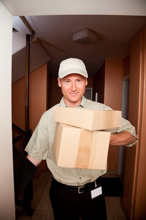 delivery boy: Delivery Boy At Your Door Stock Photo