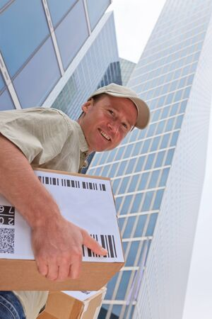delivery boy: Delivery Boy Standing In Front Of Modern Buildings