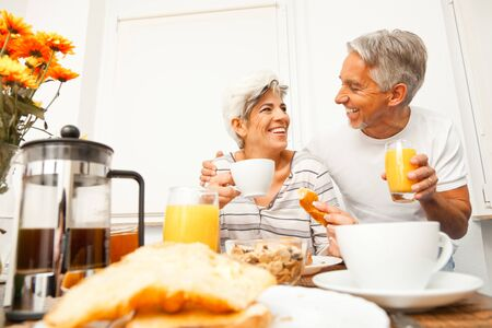 mid morning: Happy Senior Couple Having Breakfast
