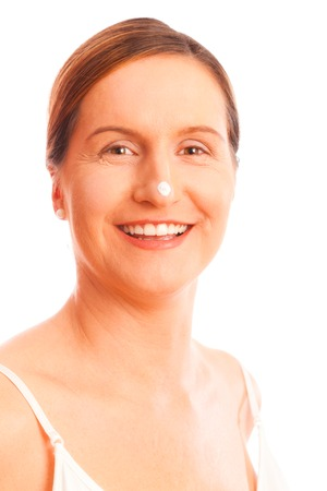 Anti-ageing Concept: Woman In Her Forties With Skin Cream