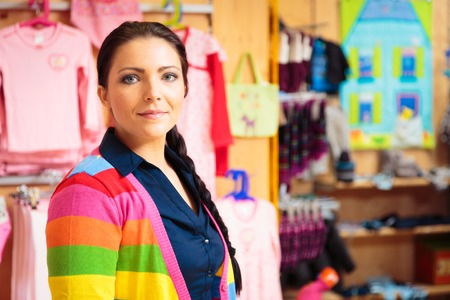 sales person: Friendly Sales Person At Childrens Store Stock Photo