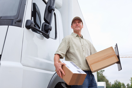 delivery boy: Delivery Boy Standing Next To A Truck Stock Photo