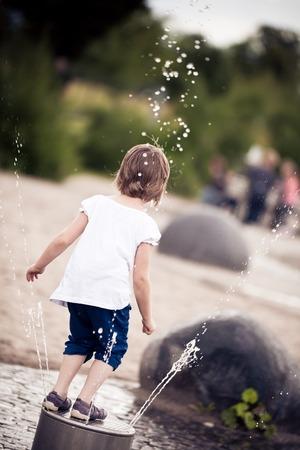 Little Girl Having Fun On The Playground Stock Photo