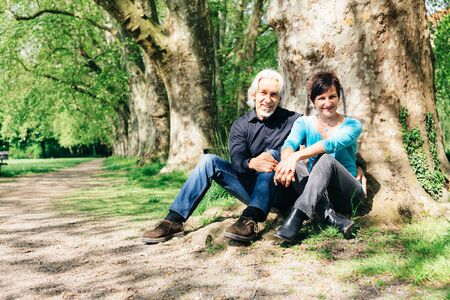 Senior Couple Resting In A Park Stock Photo
