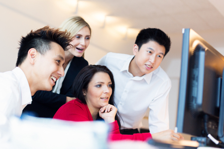 Young Creative Team Working On Their Computer