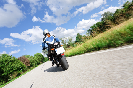 one mature woman only: Adult Woman Riding Her Motorcycle
