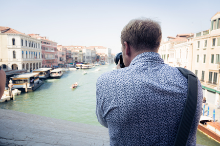 sight seeing: Tourist To Venice Taking Pictures Stock Photo