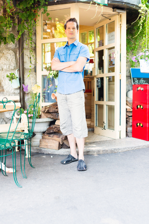 mid adult: Mid Adult Business Owner In Front Of His Cafe