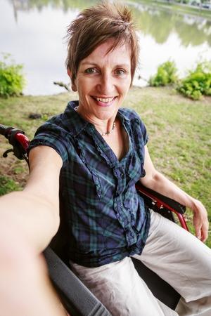 impaired: Senior Woman In Wheelchair