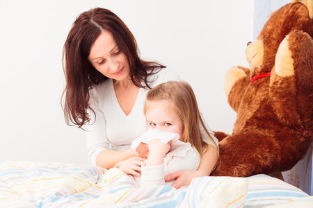 Little Sick Girl Blowing Her Nose Stock Photo