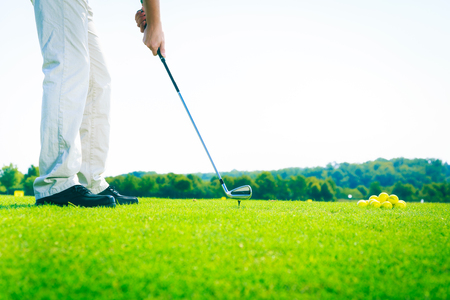 only one mid adult male: Golf Player Practicing