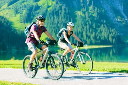 Cycling Seniors in Austria Stock Photo