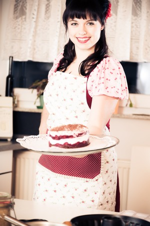 imagery: Vintage Girl Baking A Cake Stock Photo