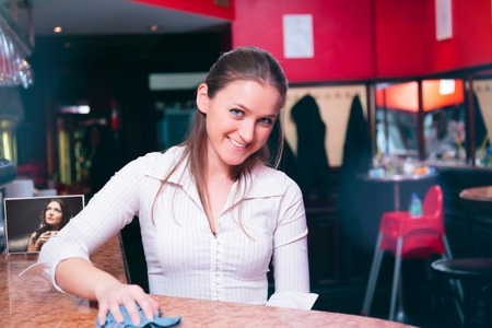 Friendly Waiter Taking Cleaning The Tables Stock Photo
