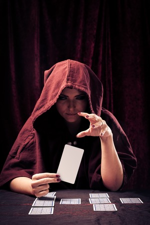 Spooky Fortune Teller With Tarot Cards Stock Photo - 70182602