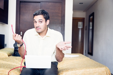 Businessman In Hotel Room Does Not Have Internet Access