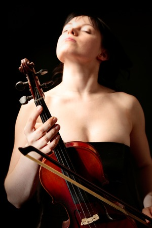 Young Woman With Old Violin Stock Photo