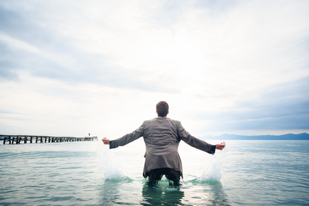 Businessman Knee-deep In Water