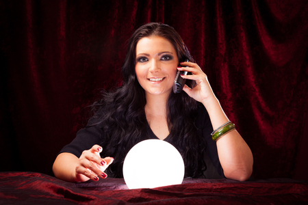 Friendly Fortune Teller With Crystal Ball Stockfoto