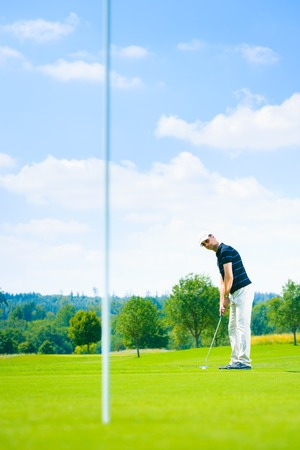 only one mid adult male: Golf Player Putting
